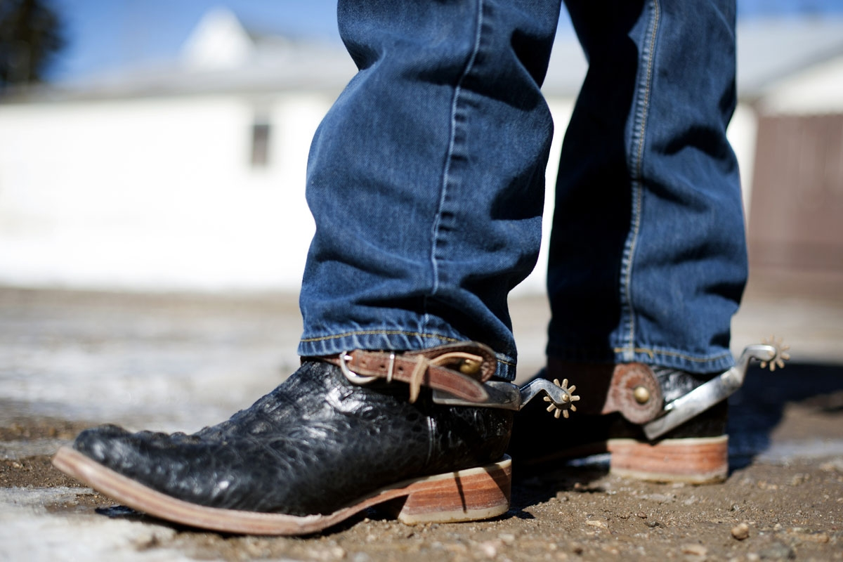A rider displays his ornate cowboy boots and spurs before riding in the 68th annual Leadville Ski Joring weekend competition on Saturday, March 4, 2017 in Leadville, Colorado.