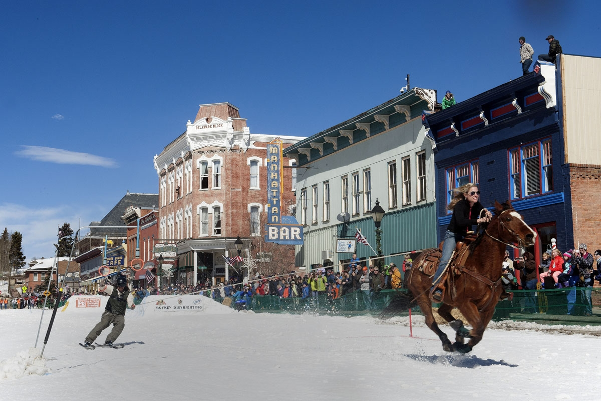 A rider races down Harrison Avenue while a skier navigates the course during the 68th annual Leadville Ski Joring weekend competition on Saturday, March 4, 2017 in Leadville, Colorado.
