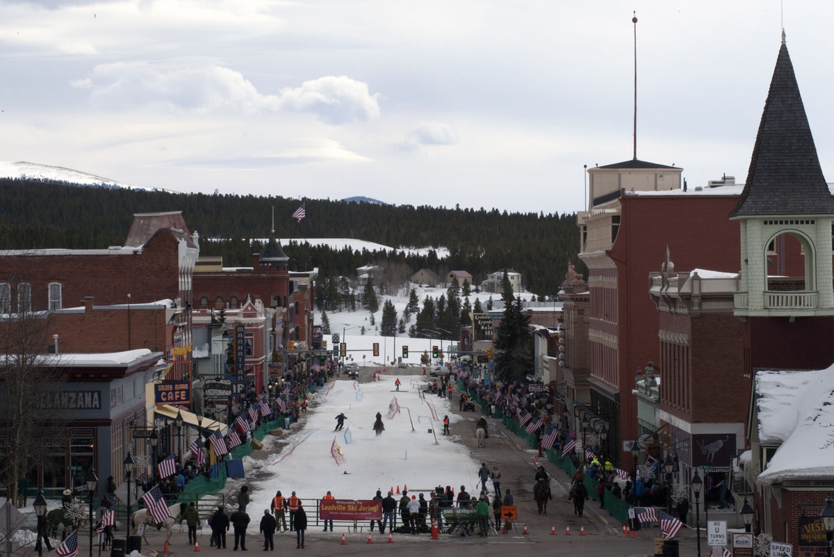 Spectators line the sidewalks of historic Harrison Avenue in Leadville, Colorado to watch the 68th annual Leadville Ski Joring weekend competition on March 5, 2017.