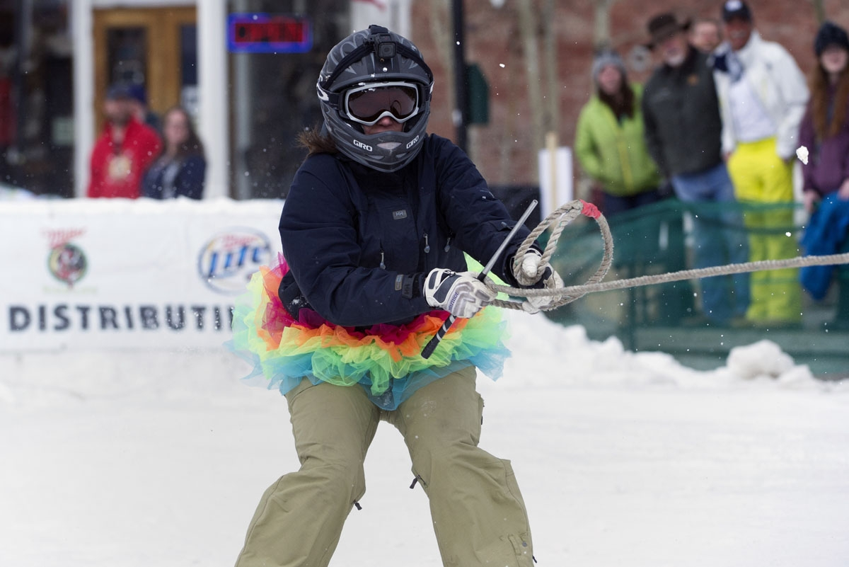 Skier Erika Hall of Buena Vista, Colorado races down Harrison Avenue during the 68th annual Leadville Ski Joring weekend competition on March 5, 2017 in Leadville, Colorado.