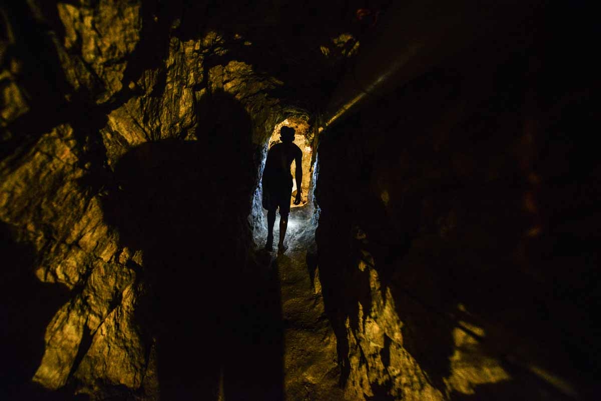 A man walks in a tunnel at a gold mine in El Callao, Bolivar state, southeastern Venezuela on March 1, 2017. Although life in the mines of eastern Venezuela is hard and dangerous, tens of thousands from all over the country head for the mines daily in ove