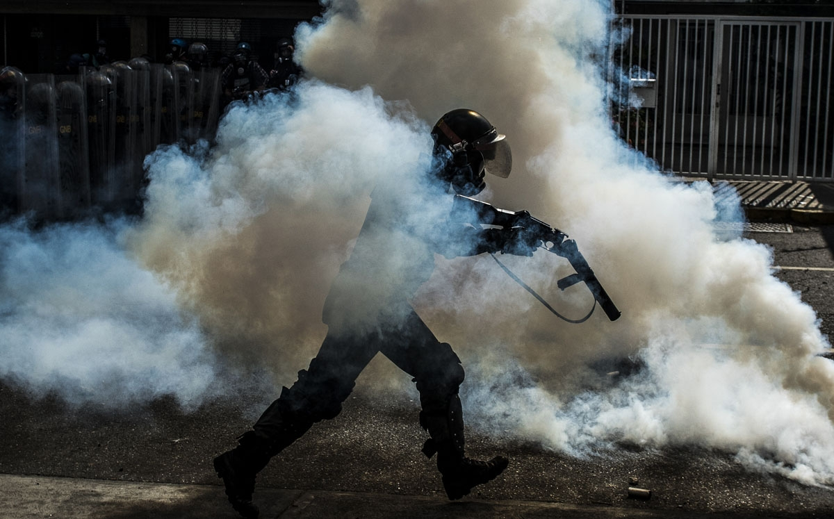 A member of the National Guard cracks down on opposition demonstrators during a march against President Nicolas Maduro, in Caracas on April 26, 2017.