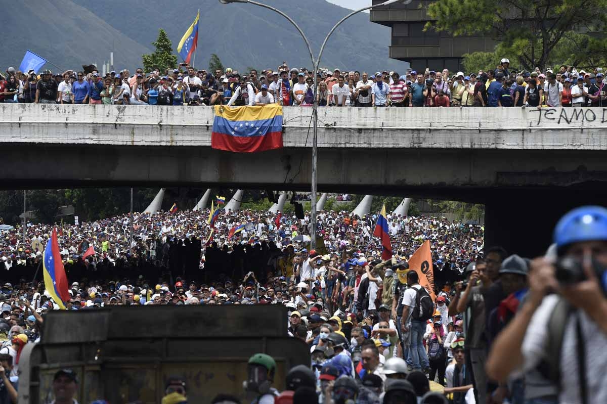 Opposition activists march during a protest against Venezuelan President Nicolas Maduro, in Caracas on May 3, 2017.