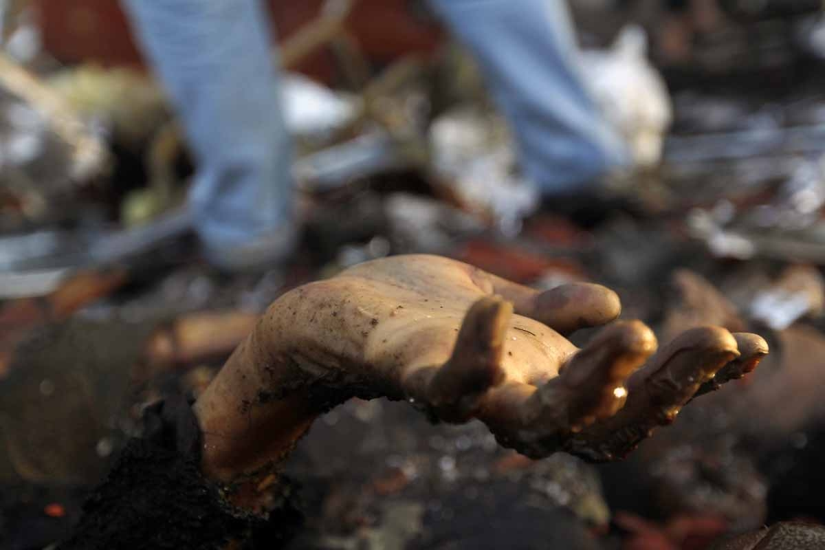 A picture taken on October 8, 2016 shows the hand of a victim amid the destruction of a funeral hall following reported airstrikes by Saudi-led coalition air-planes on the capital Sanaa.