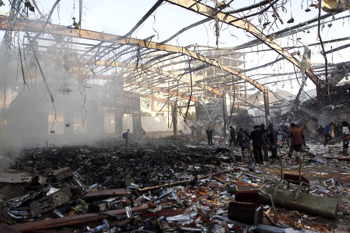A picture taken on October 8, 2016 shows a general view of the destruction following reported airstrikes on a funeral hall by Saudi-led coalition air-planes on a building in the capital Sanaa.