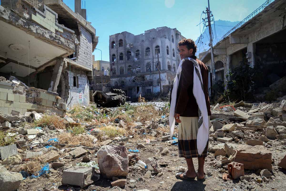 A Yemeni man inspects the damage on a street following clashes between pro-government militants, loyal to President Abedrabbo Mansour Hadi, and Shiite Huthi rebels on November 22, 2016 in the country's third-city Taez.