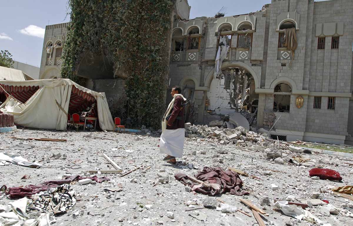 A gunmen loyal to former Yemeni President Ali Abdullah Saleh, stands amid the wreckage of Saleh's residence following reported air strikes on his residence, on May 10, 2015, in the capital Sanaa.