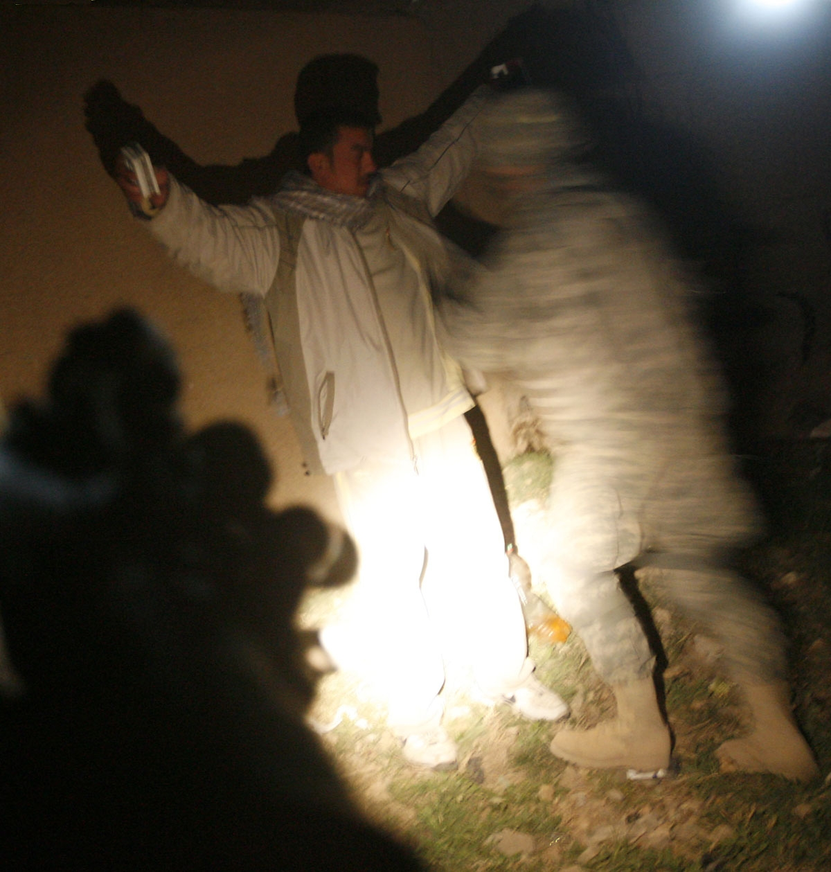 A US soldier from the 2nd Battallion 12th Field Artillery Regiment, 4-2 SBCT, frisks a man during a night patrol in the town of Baquba, 20 kms northeast of Baghdad, on February 23, 2008. T