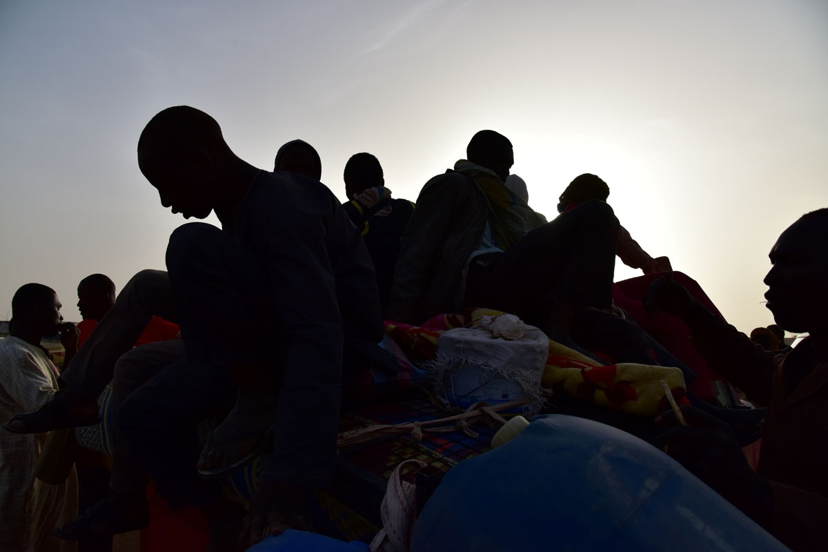 A picture taken on March 31, 2017 shows West African migrants returning from Niger after fleeing Libya due to armed groups by pickup truck in Agadez, northern Niger, following their failed attempt to reach Europe by crossing the Mediterranean Sea.