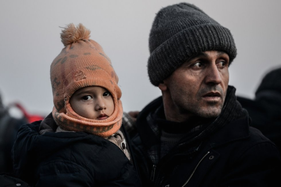 Migrant father and child. January 27, 2016.
