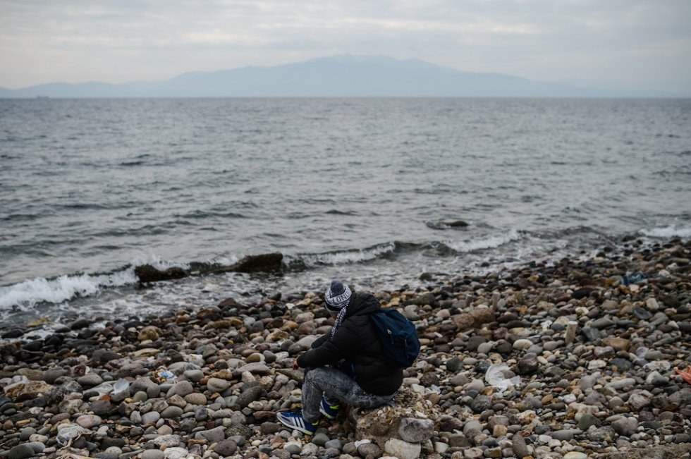 A Syrian migrant looks out onto the sea after being stopped by Turkish police in his attempt to reach the Greek island of Lesbos. January 29, 2016.