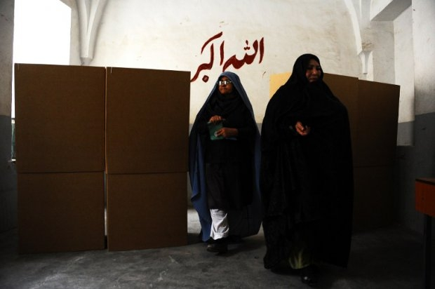 Afghan women leave voting booths after filling their ballots at a polling station in the northwestern city of Herat on April 5, 2014.