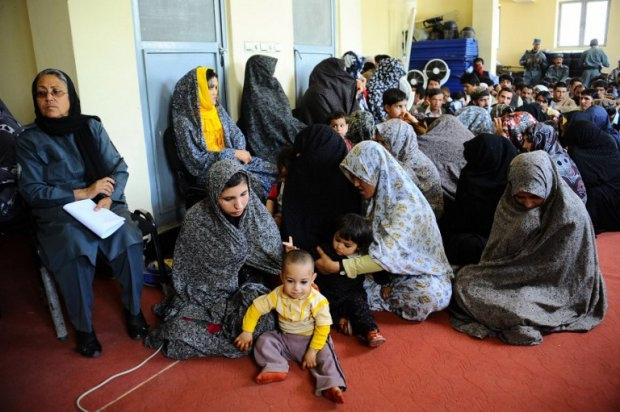 Women prisoners hold their children as they await release from a prison in Herat on May 6, 2014.