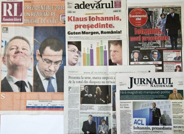 Romanian main newspapers announce the victory of the opposition candidate for presidential elections, Klaus Iohannis, a member of the country's German minority, on November 17, 2014 (AFP Photo / Daniel Mihailescu)