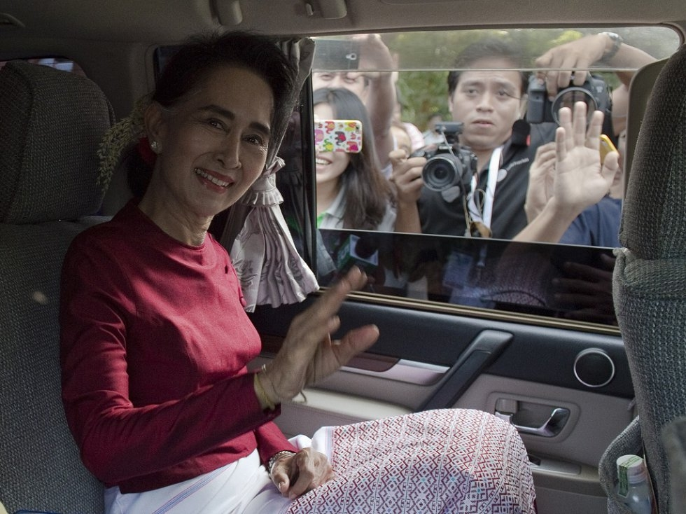 Suu Kyi smiles as she leaves her house to cast a ballot in the November 8 poll. (AFP/Nicolas Asfouri)
