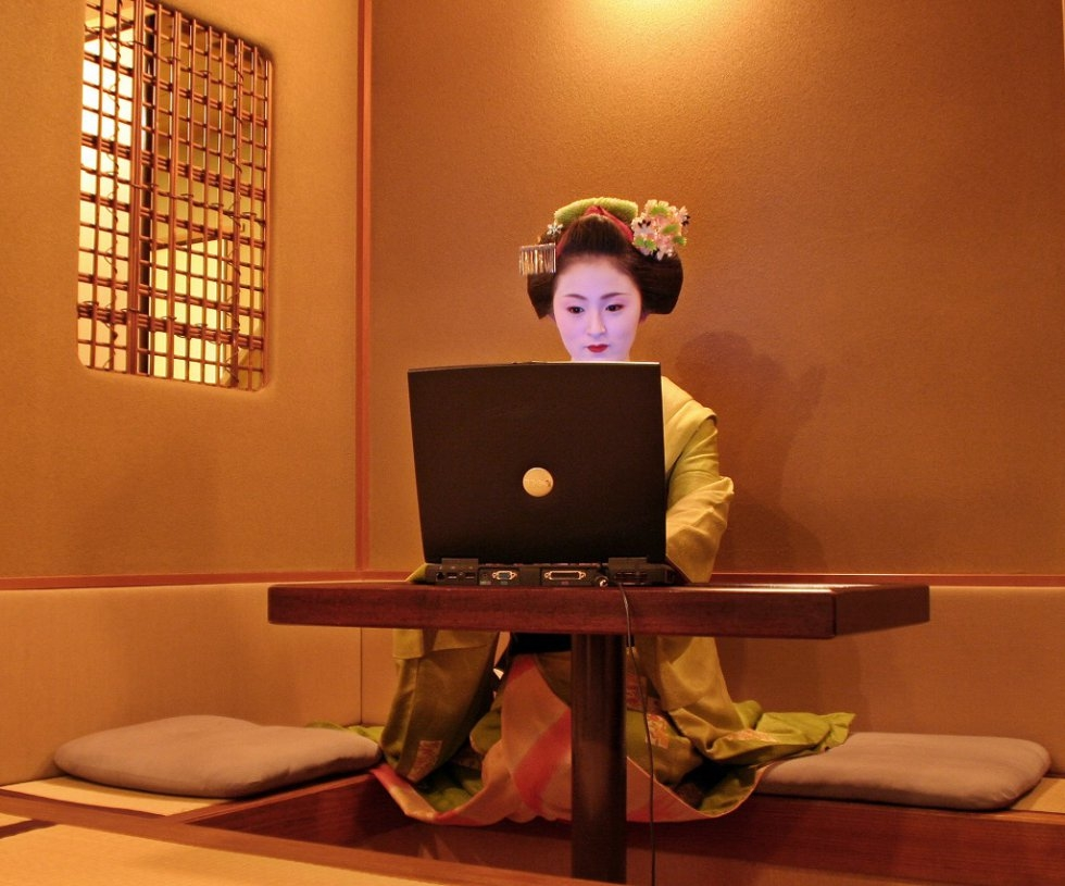 A geisha apprentice in front of her computer at a Kyoto teahouse in December, 2006.