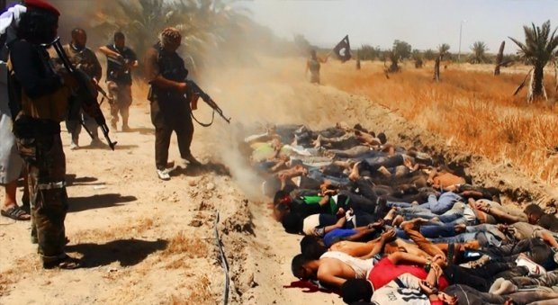 An image uploaded on June 14, 2014 on the jihadist website Welayat Salahuddin allegedly shows militants of the Islamic State of Iraq and the Levant (ISIL) executing dozens of captured Iraqi security force members. (AFP / HO / Welayat Salahuddin)