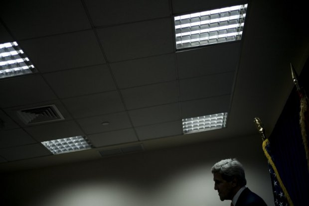 US Secretary of State John Kerry pauses while speaking during a press conference at the US embassy in the International Zone June 23, 2014 in the Iraqi capital Baghdad. (AFP Photo/POOL/Brendan Smialowski)