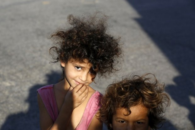 Displaced Palestinian children pose for a picture in Gaza City on July 26, 2014.