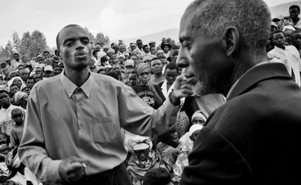 A Rwandan civilian publicly confronts an inmate during a gacaca session, October 16, 2001.