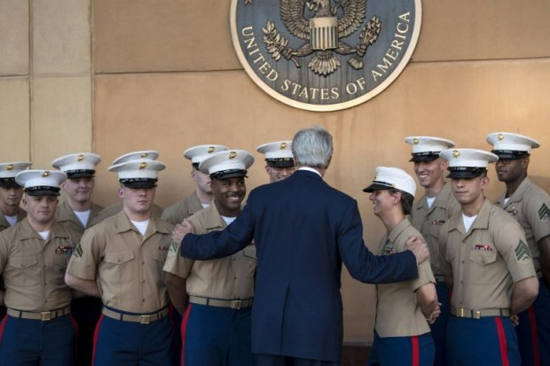 US Secretary of State John Kerry greets US marines as he arrives at the US embassy in the International Zone June 23, 2014 in the Iraqi capital Baghdad.