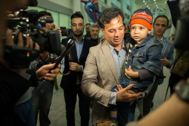 Bashir Mirzad holds his nephew Abuzar Ahmad as he is greeted by nearly 100 family and well wishers at Pearson Airport in Toronto, Ontario, Canada, April 30, 2014