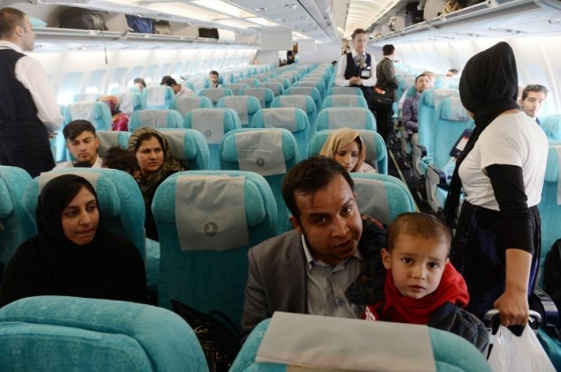 Abuzar sits with his cousin Turaj in a plane moments before leaving Kabul for Canada