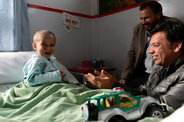 Abuzar plays during a visit by his uncle Bashir Mirzad