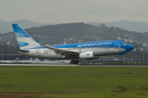 "An Aerolineas Argentinas airliner lands at Sao Paulo International Airport, on November 2013. Chequeado.com has declared ""exagerated"" a claim by the state-run airline thait it had put all its financial records on its website"