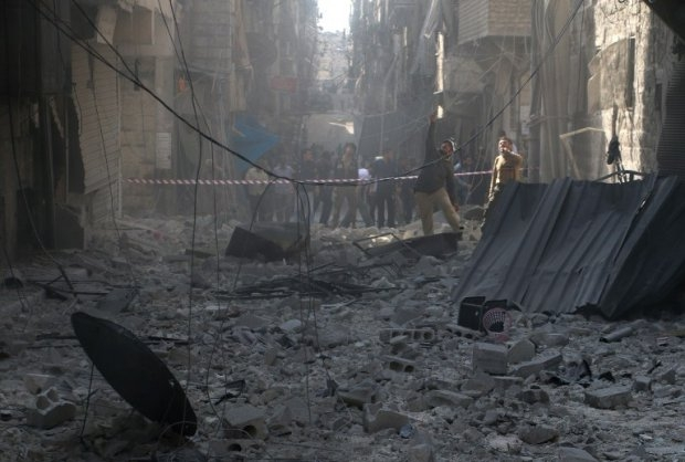 A street of Aleppo is filled with debris following an attack by government forces on October 31, 2014