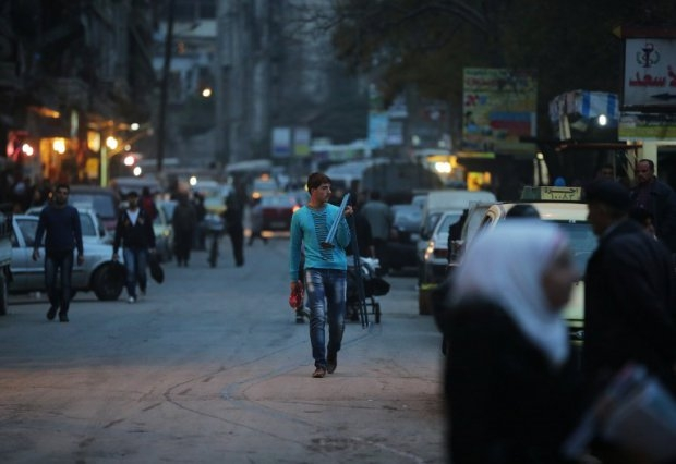 Syrians shop in the al-Midan neighbourhood on the government-held side of Aleppo on November 16, 2014