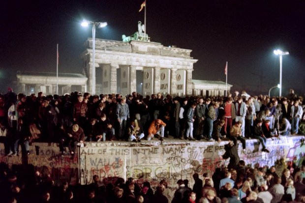 Thousands of young East Berliners crowd atop the Berlin Wall, near the Brandenburg Gate on November 11, 1989