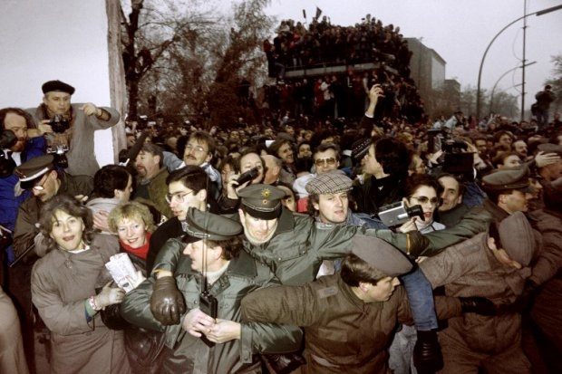 East and West German Police contain the crowd of East Berliners flowing through the recent opening made in the Berlin wall at Potsdamer Square, on November 12, 1989
