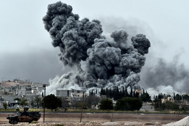 Smoke rises after a strike on Kobane, seen from the Turkish-Syrian border on October 12, 2014