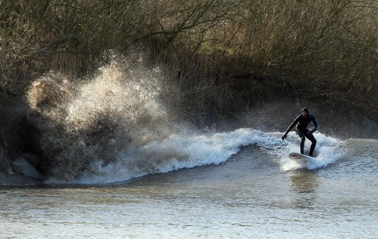 Riding the Severn bore at Minsterworth, southwest England on March 21, 2015