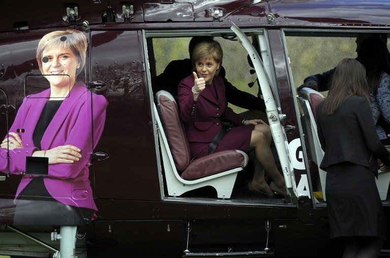 First Minister of Scotland and Leader of the Scottish National Party Nicola Sturgeon boards a helicopter in Edinburgh, Scotland, on April 30, 2015