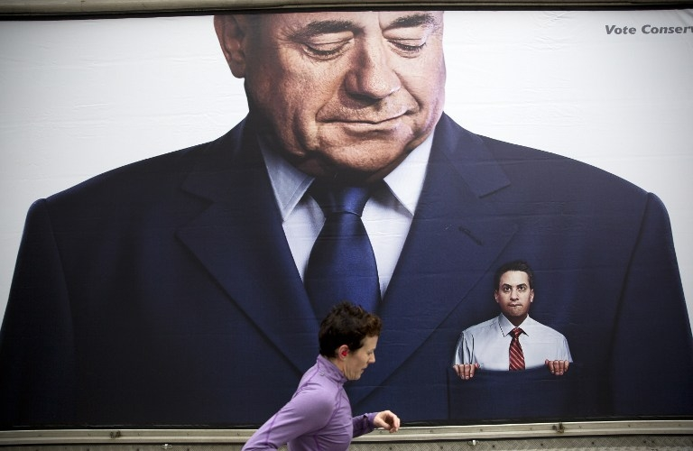 A lorry displays a Conservative poster picturing Labour Party Leader Ed Miliband in the pocket of former Scottish First Minister Alex Salmond, in Birmingham, central England on March 14, 2015