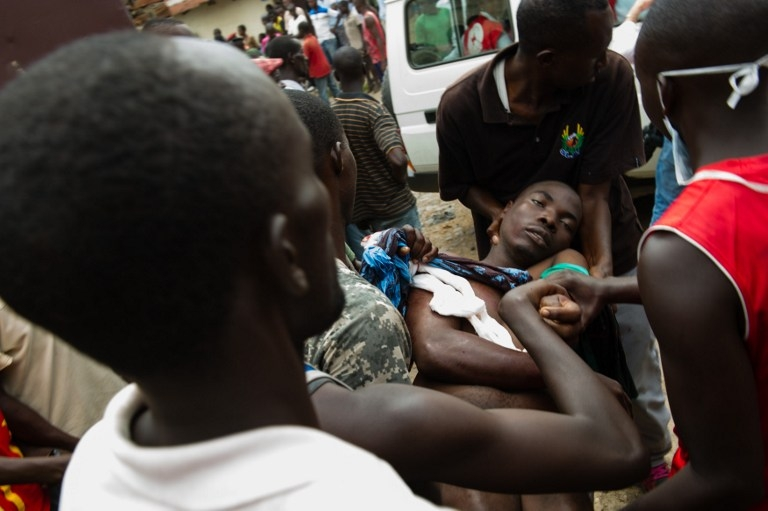 A man identified as Pascal, who was injured by a gunshot and later died, is carried to an ambulance in the Musaga neighbourhood of Bujumbura, on May 4, 2015