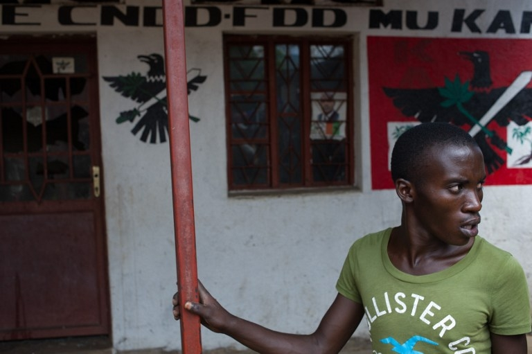 A member of the Imbonerakure, the youth wing of Burundi's CNDD-FDD ruling party, outside the local party offices in the Kanyosha neighbourhood of Bujumbura on May 6, 2015