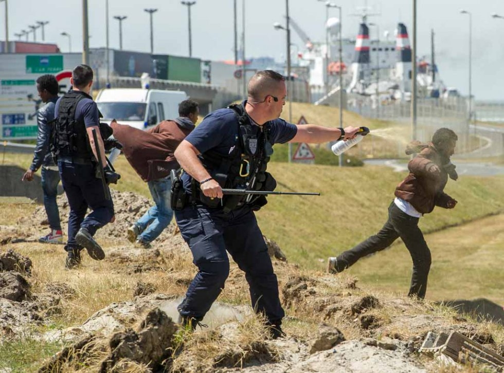 French riot police prevent migrants from sneaking onto trucks heading to England