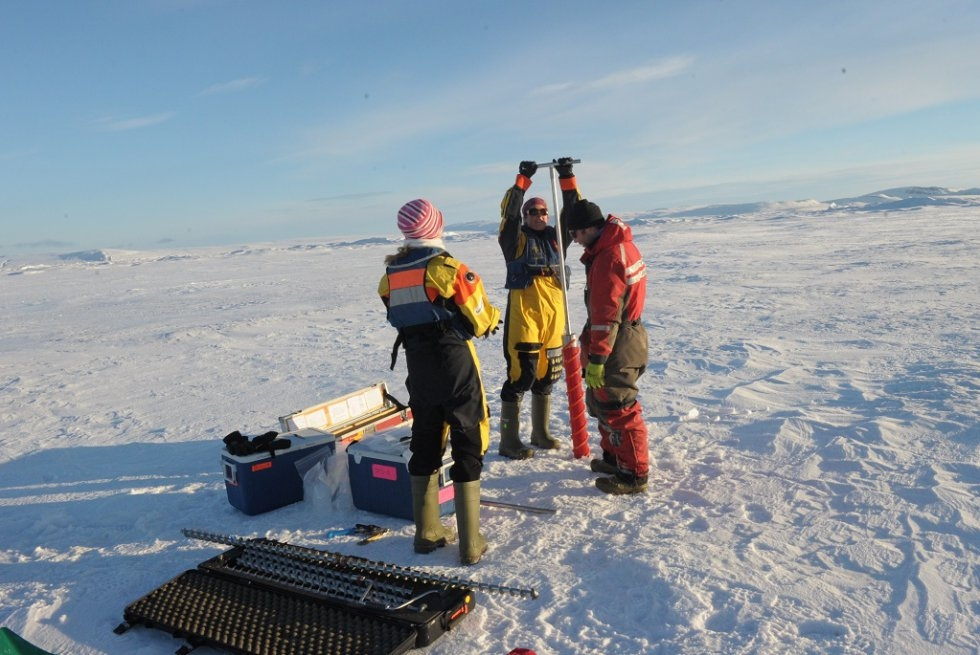 Scientists take measurements in the ice