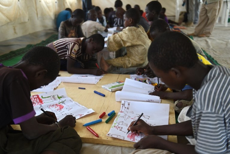 Young Nigerian refugees during an art therapy workshop at a camp near Baga Sola on April 6, 2015