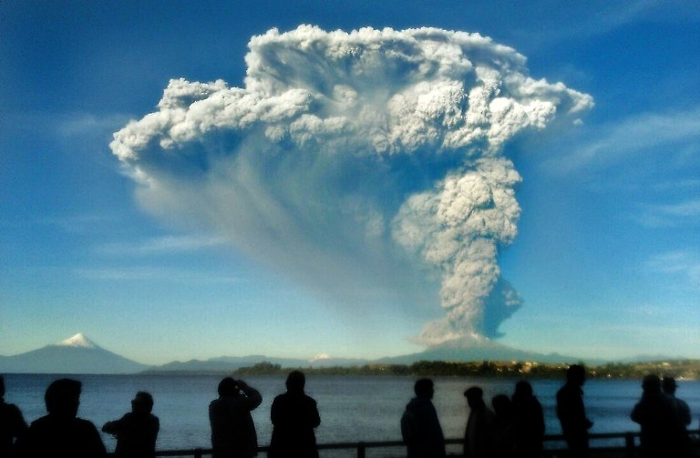 A picture taken with a cellphone shows people watching the Calbuco from Puerto Varas on April 22
