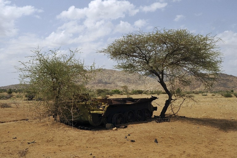A rusted out Soviet-era tank sits abandoned by the road in western Eritrea on July 18, 2013