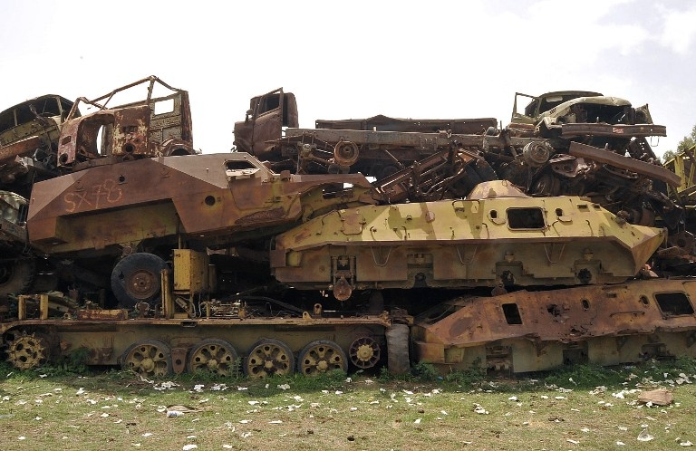 Soviet-era tanks and trunks sit abandoned in Asmara's tank graveyard on July 20, 2013