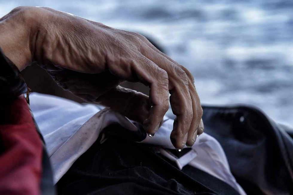 Water drips off the hand of a dead man whose body washed up on Lesbos's shore in early November.