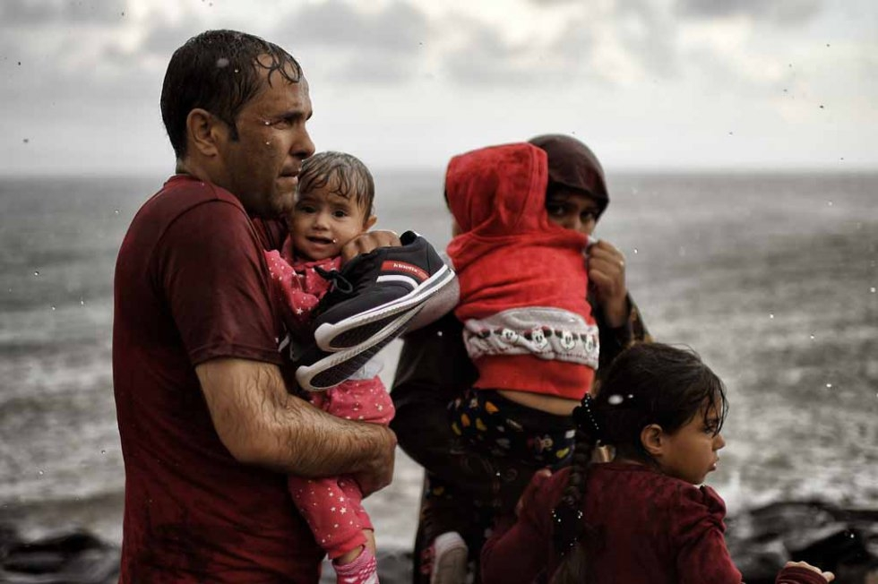 A soaked family arrives on the shores of Lesbos in late September.