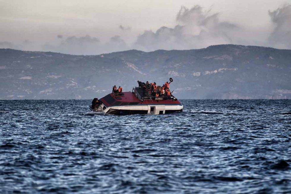 A boat filled with migrants sinks off Lesbos in late October.
