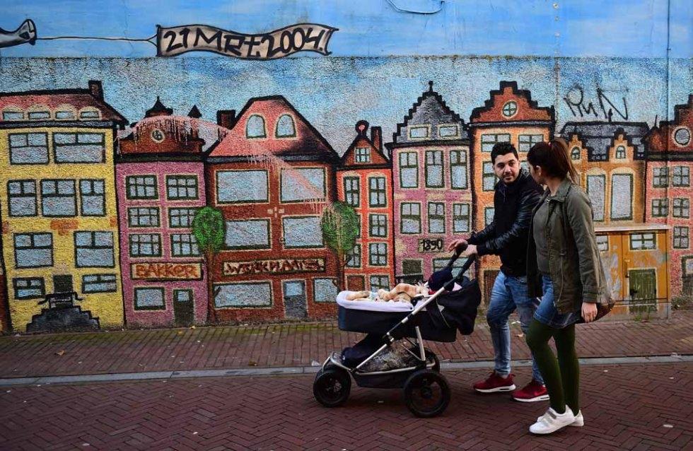 Ahmad and Alia take Adam for a walk. (AFP/Emmanuel Dunand)