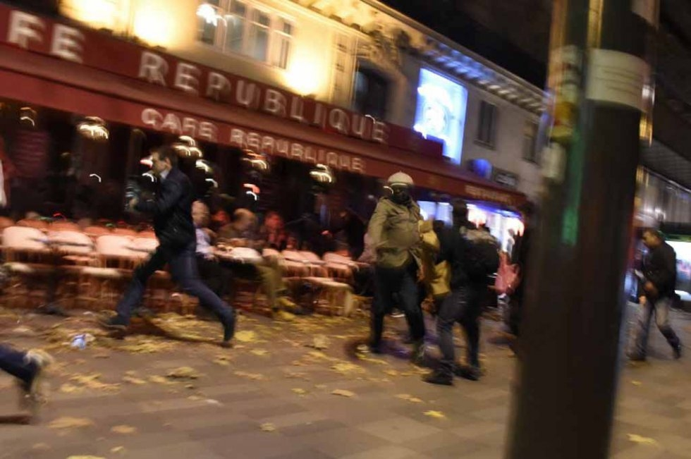 People run in panic after thinking they heard shots near the Place de la Republique on the night of the Paris attacks on November 13, 2015.